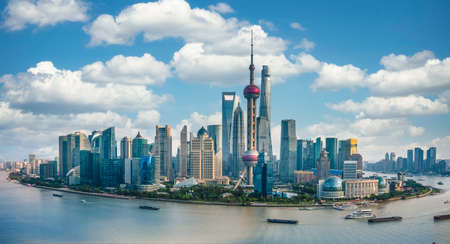 Panorama of the skyline of Shanghai urban and huangpu river, China, on a sunny day Editorial