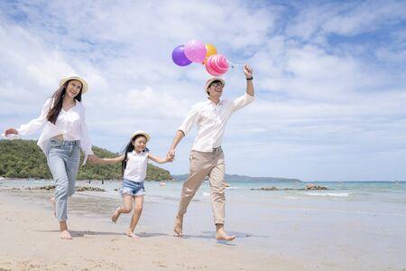 happy asian family enjoy summer vacation on the pattaya beach Archivio Fotografico