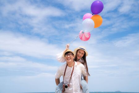 Asian couple run togather on the beach between honeymoon in resort in Phuket island, Thailand, Summer, beach, holiday, travel, family and valentine concept