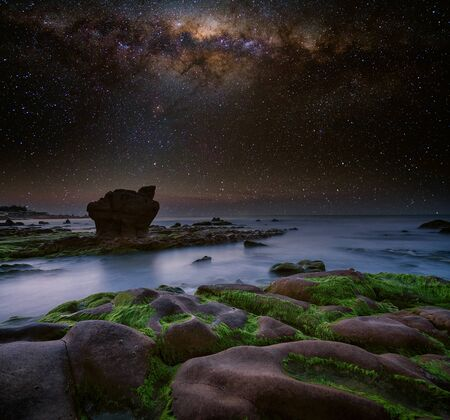 Nam O Beach, Da Nang Beach is a beautiful beach in Danang city , Vietnam. Beautiful moss rocks and milky way at the beach is interesting for travel and take a photo. Stock fotó
