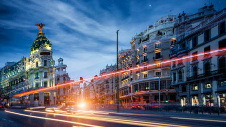 Madrid, Spain cityscape at Calle de Alcala and Gran Via on night and trafic light, madrid