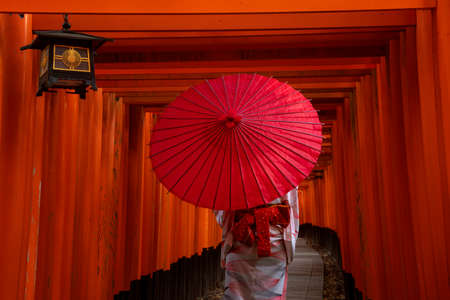 Women in traditional japanese kimonos walking at Fushimi Inari Shrine in Kyoto, Japan Editorial