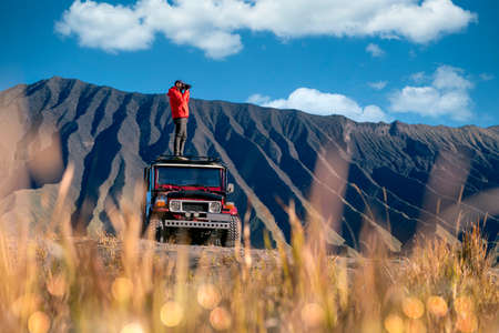 Asian traveller travel in terrace rice farm in bali, indonesia