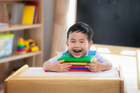 Asian student happy after back to school and smile in his class room in preschool, this image can use for education, student, school and stydy concept Imagens