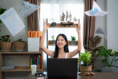 Portrait of a young excited intern celebrating success at office, this image can use for office, home office, goal and education concept