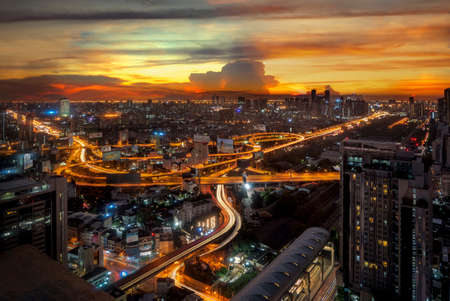 Light from road and high way in Bangkok city in morning sunrise time, Thake picture from Hotel windows Imagens