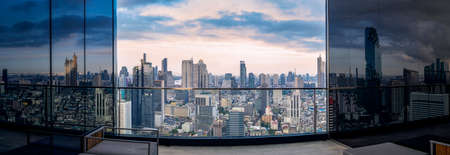 Bangkok city view from roof top of Hotel building with high building and  blue sky background. Imagens