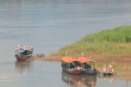 loei: Three boats on MeKhong River,Chiang Khan District,Loei Province,Thailand Stock Photo
