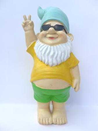 Garden gnome wearing sunglasses against white background