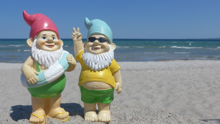 Two garden gnomes make seaside holiday