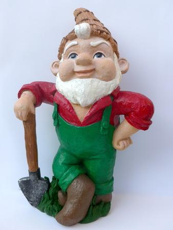 Garden dwarf with shovel against white background