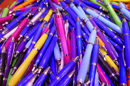 Many colorful, glossy ballpoint pens