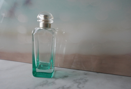 Glass bottle, bottle, bottle in front of pastel colored background