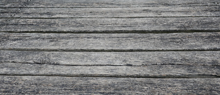 Old weathered wooden planks at the harbor. Close-up