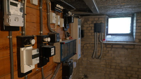 Electrical fuse boxes and power lines in the basement of an old apartment building Imagens