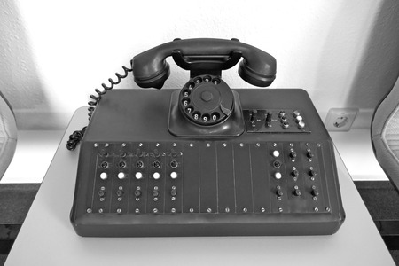 Old, black dial telephone. Old telephone system, PBX, from GDR times. Nostalgia, rarity.
