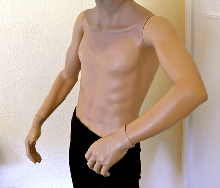 Male torso, mannequin, half naked headless, wearing a black trousers