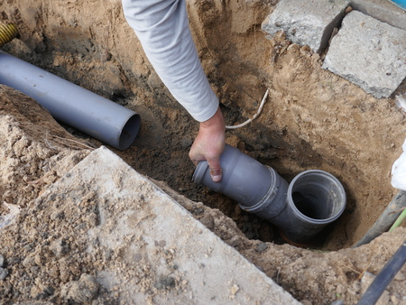 Laying and installing a sewer pipe 스톡 콘텐츠