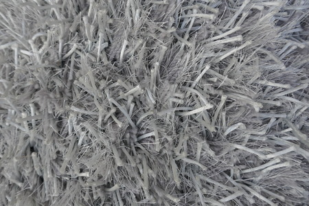 Carpet fibers, gray. Close-up, background and texture