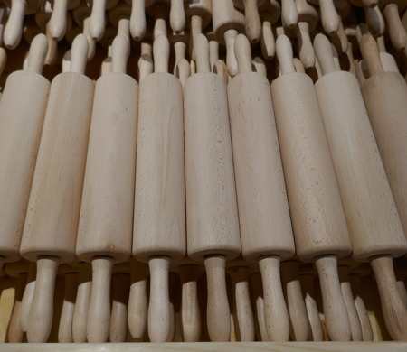 Many noodle rolls or rolling pins. Plastic-free kitchen utensils made of wood. Close up, texture, background