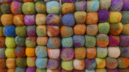 Colorful background made of small felt balls. 스톡 콘텐츠