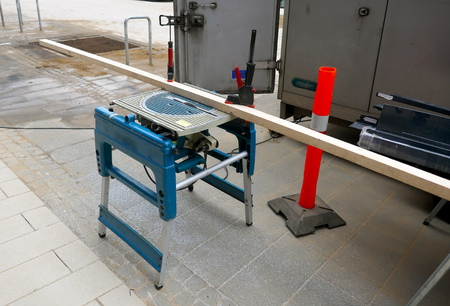 Modern, mobile table saw, folding and swiveling, outside on a construction site