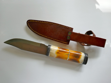 Knife hunting knife with deer horn handle and leather sheath 写真素材