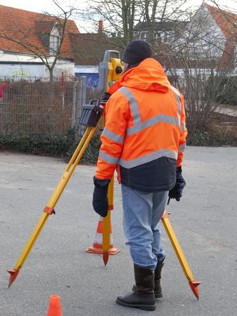 Surveyor, a civil engineer with surveying equipment to prepare a construction site Reklamní fotografie