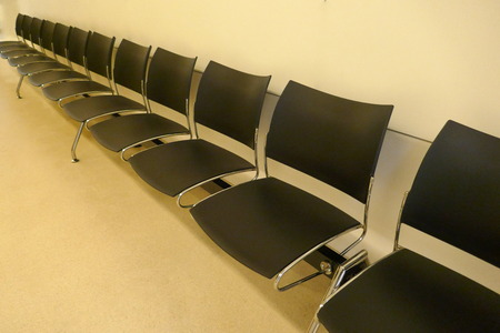 Modern waiting room with black chairs Stock Photo