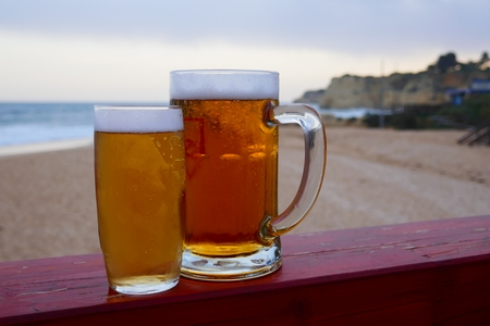 A small and a big beer in the afternoon on the beach