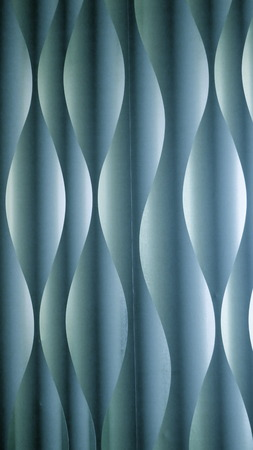 Background and texture, paper, turquoise, blue, green. Abstract wave or spiral pattern with light and shadow effect.