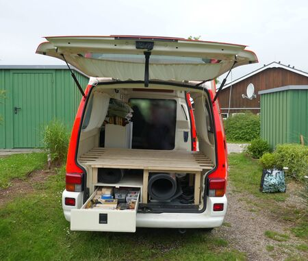 Conversion of a disused ambulance to the motorhome. Installation of a pedestal with storage space, drawers and slatted frame for a bed.