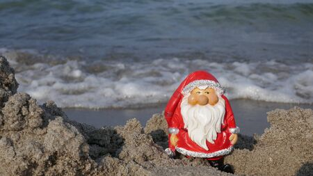 Christmas by the sea. Have fun at the beach holiday with Santa Claus. (Not copyrighted) Zdjęcie Seryjne - 130686036