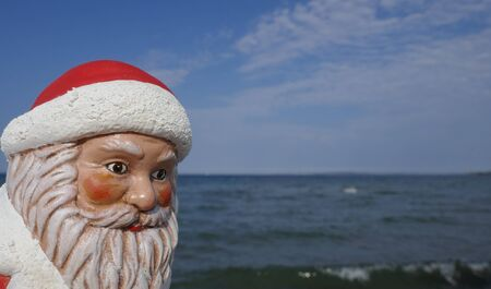 Christmas by the sea. Have fun at the beach holiday with Santa Claus