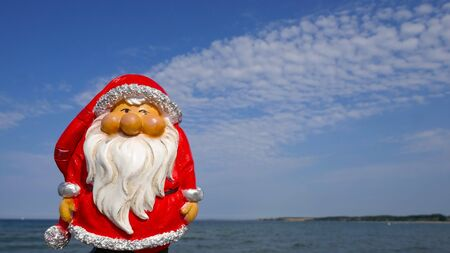 Christmas by the sea. Have fun at the beach holiday with Santa Claus. Not copyrighted