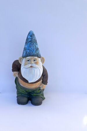 Garden gnome with naked belly. Isolated on white background. (not protected by copyright) Stockfoto