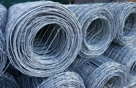 Wire mesh fence, rolled up. Close up, texture, background,