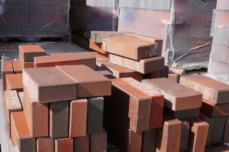Red paving stones in the building materials trade for sale. Close-up
