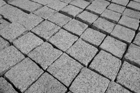 Granite stones for natural stone paving in the building materials for sale, close-up
