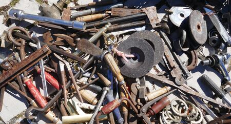 Jumble of old rusty hand tools