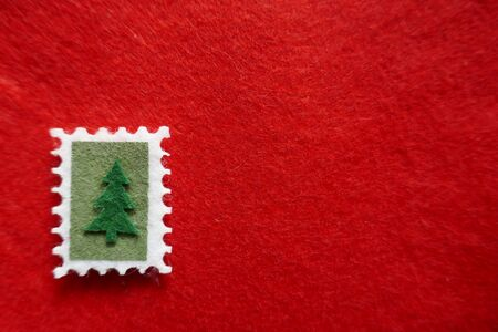 Christmas, Christmas motives, Christmas card. Christmas tree on red felt. Background, Texture, Close-up