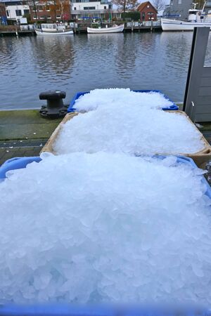 Ice, icy. Crushed ice in big containers for freshly caught fish. Heiligenhafen, Schleswig-Holstein, Germany, Europe.