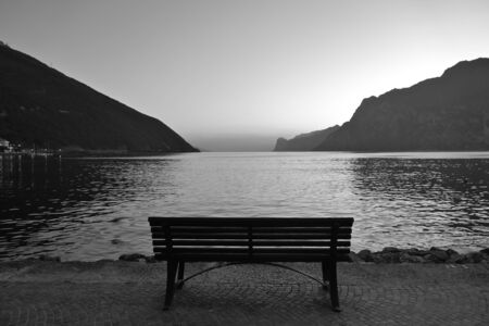 Lonely wooden bench by the lake at first dawn Stok Fotoğraf