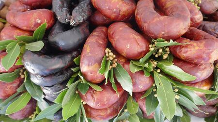 Traditional sausage specialties from Spain and Portugal at the market in Portugal. Stok Fotoğraf