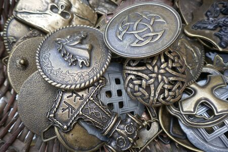 Brass and bronze brooches, viking brooches of brass and bronze. Many different old brooches on a medieval market in Schleswig-Holstein, Germany, Europe Stok Fotoğraf