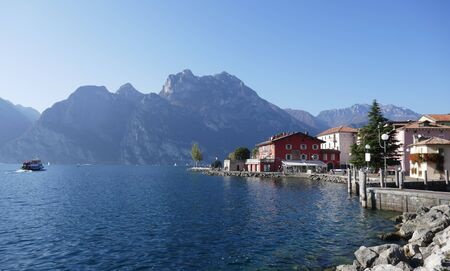 Torbole, Italy, Europe, October 26, 2019: View of Torbole and the mountains on the shores of Lake Garda. Torbole am is a popular vacation spot in Northern Italy.