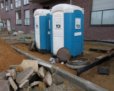Mobile toilets cabins, dixie closets. WC Toilets for construction workers on a construction site in front of a building