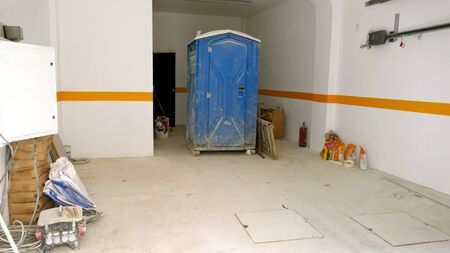 Mobile construction site toilet, dixie closet. Toilet for construction workers in a building