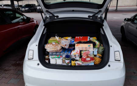 Armacao de Pera, Portugal, Europe - O3 / 05/2020: Open trunk of a white car full of food after a supermarket purchase in Portugal, during the Corona crisis in March 2020.