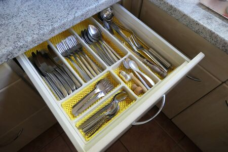 View of an open cutlery drawer in a kitchen